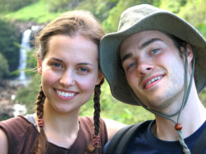 couple hiking and smiling